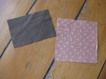 The brown fabric will form the outside of the pocket; the pink fabric becomes the lining and contrast strip