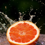 Grapefruit splashed with water