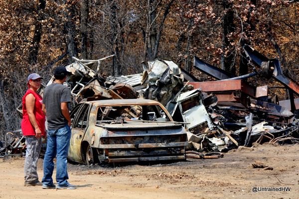 Pile of metal scrap and burned out car after a fire