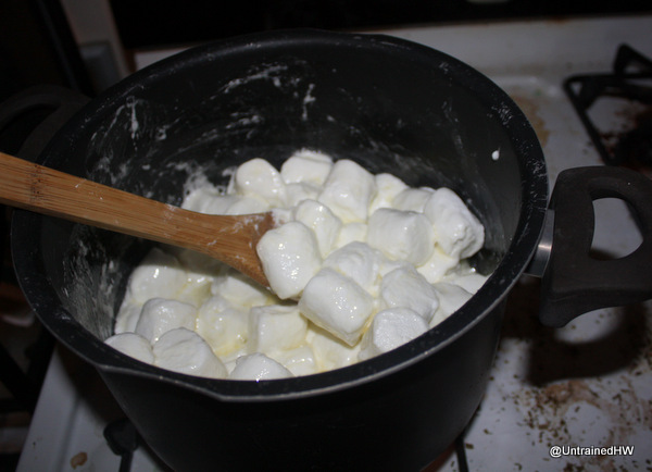 Melt the butter and marshmallows in a sauce pan until everything is ...