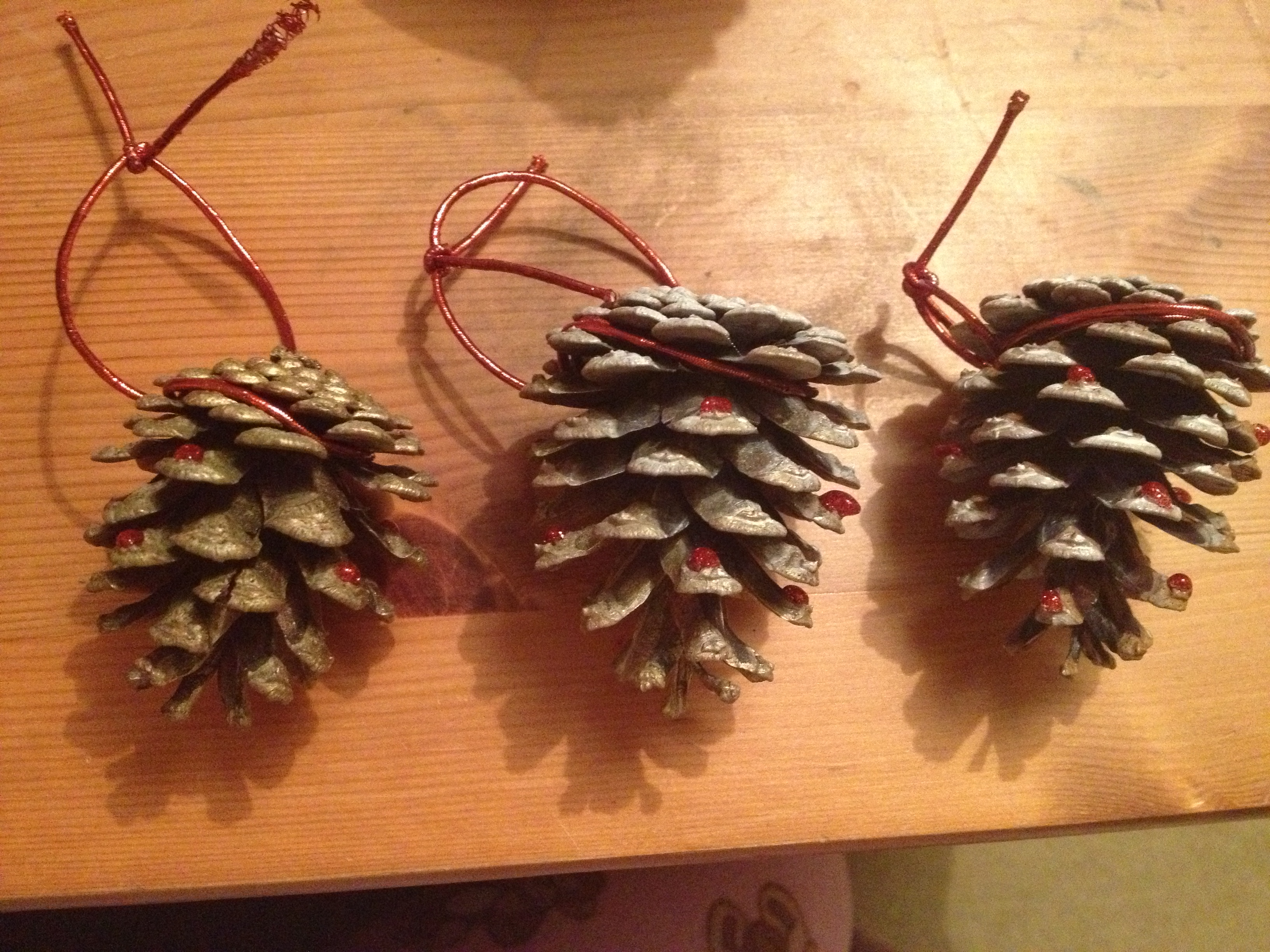 theyre simple and fun to make with your family its amazing what you can do with a few little things and they will make your christmas that extra special - Pine Cone Christmas Tree Decorations